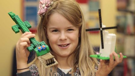 Anna Judd holds up her creations at Framlingham Library Lego Club on Saturday. Picture: NIGE BROWN
