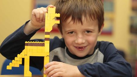 Reuben with his Lego at Framlingham Library Lego Club on Saturday. Picture: NIGE BROWN
