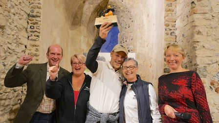 The winners at the Framlingham Sausage Festival, the Suffolk Black Pig Company, with their award. Pi