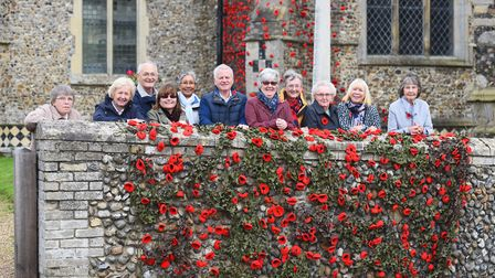 Residents from Walsham le Willows have yarn bombed the church with poppies in the run-up to Remembra