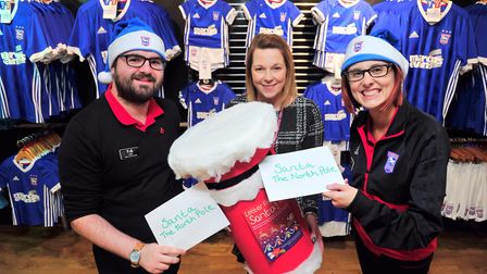 Launch of the EACH Letter from Santa campaign at Planet Blue. L-R Luke Keeble,Vicky Matthews and La