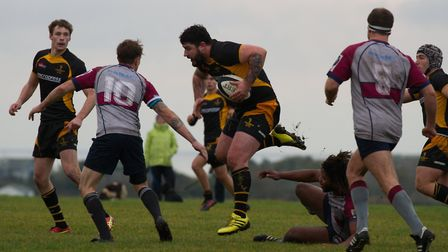 Matt Howell charges through for Southwold against West Norfolk on Saturday. Photo: Linda Cayley