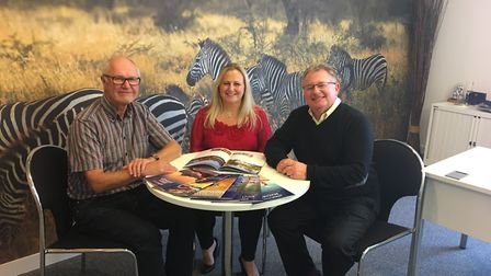 Niki Waters with Premier Travel Group co-owners Peter Andrews (left) and Renford Sargent (right). Pi