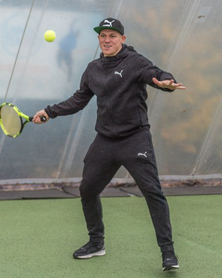 Ipswich Town star Martyn Waghorn tries his hand at tennis at the Elena Baltacha Academy. Picture: PA
