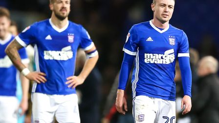 A dejected looking Freddie Sears and Luke Chambers walk off the pitch after the Blues were denied th