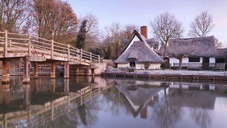 Bridge cottage at Flatford in Winter, enjoy a festive afternoon there this weekend. Picture: NATIONA