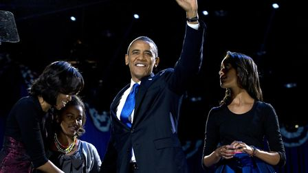 Barack Obama with Michelle Obama and daughters Malia and Sasha. Picture: (AP Photo/Carolyn Kaster)