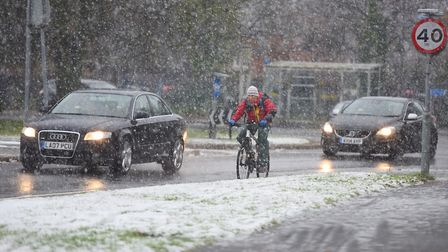 Cyclist braves the elements in Ipswich. Picture: GREGG BROWN