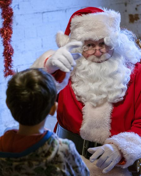 Father Christmas at Nowton Park Walled Garden, talking to Jake. (2016) Picture: MARK BULLIMORE