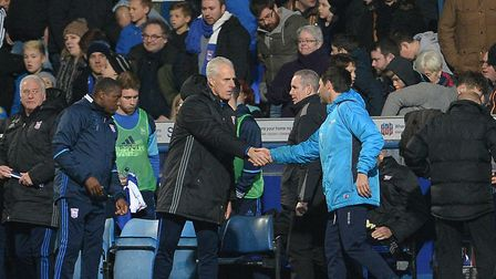 Mick McCarthy and Cowley shake hands after the 2-2 FA Cup draw last season. Lincoln won the replay 1