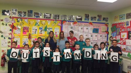 Staff and pupils at Rendlesham After School Club, based at Rendlesham Primary School, celebrate the