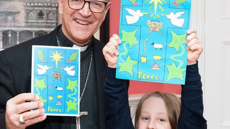 Bishop Martin Seeley with Janina Millman, aged 9. Picture: KEITH MINDHAM