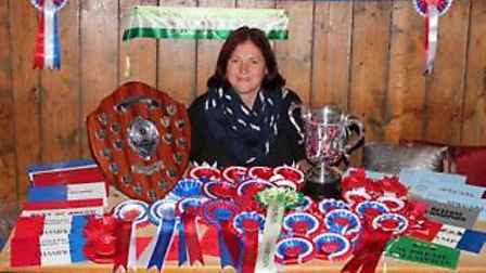 Teresa Cook, landlady at the Snape Crown, pictured with awards for her Gloucestershire Old Spot pigs