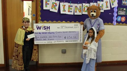 The My WiSH charity mascot Nurse Bury with pupils Samuel and Lily-Anna at Wood Ley Primary School
