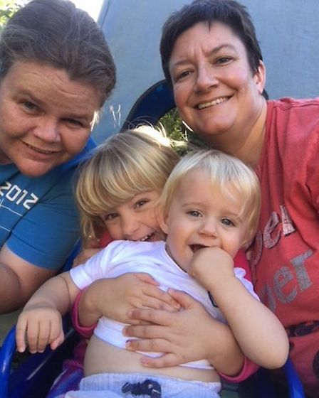 Pictured is Ella Rose Mingay with her brother William mother Michelle and her partner Liz Cotton