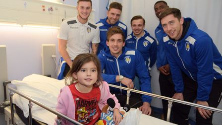 Emily Wilding with players from Colchetser United. L-R Brennan Dickenson, Doug Loft, Sam Walker, To