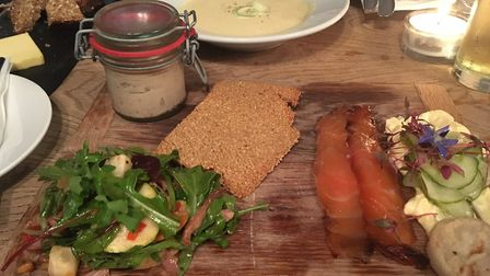 Sharing platter of smoked mackerel pate, confit duck salad and whisky and treacle cured salmon at Th