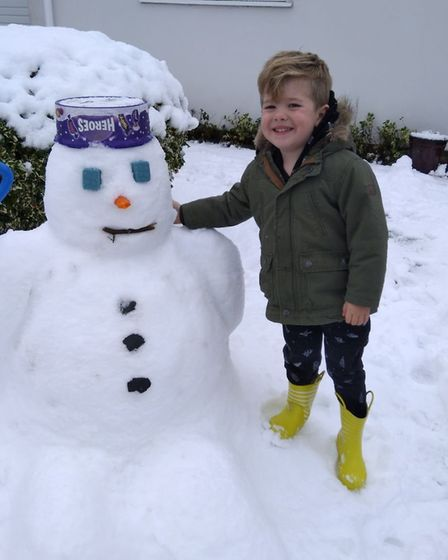 Teddy Baker, aged three from Colchester, built his first snowman. Picture: RICHARD STRAMA