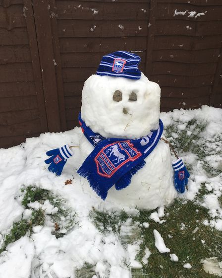 Elliot Gordon (6) and Isla Gordon (2) of Kesgrave made a Ipswich Town snow supporter! Picture: Fay T