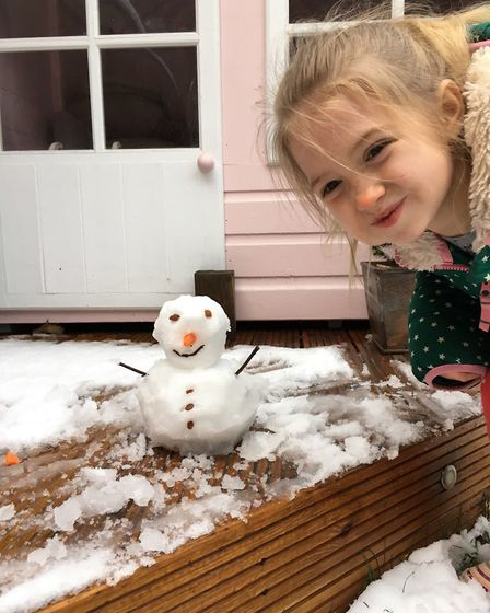 Ruby wythe age 7 from Ipswich with her snowman. Picture: Contributed