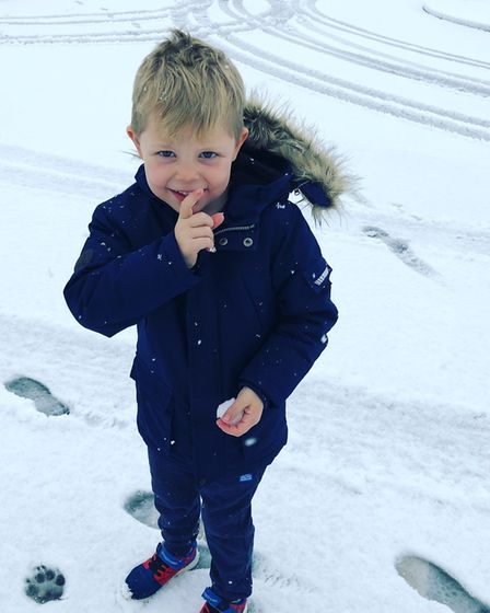 This is my son Ryland getting ready to throw a snowball at his dad! Picture: Melissa O'Halloran