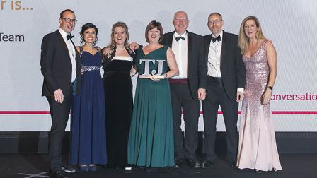 The East of England Co-op learning and development team collect their trophy at the TJ Awards in Lon