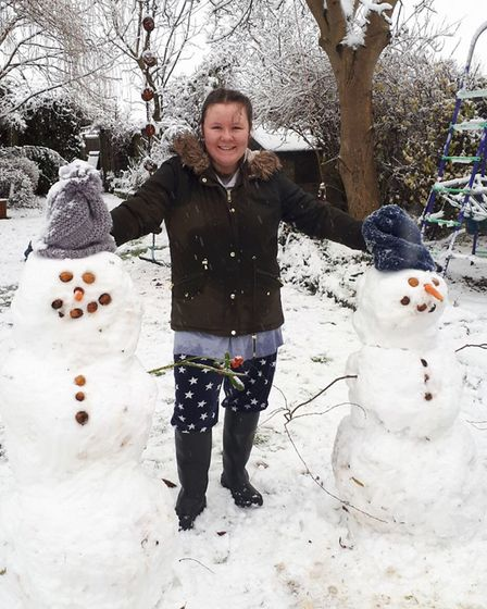 East Bergholt High School student Amelia Took with her two snowmen in Boxted, Essex. Picture: GILL T