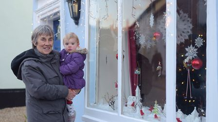 Gill Knights and Millie Smith looking at one of the decorated windows. Picture: SARAH LUCY BROWN