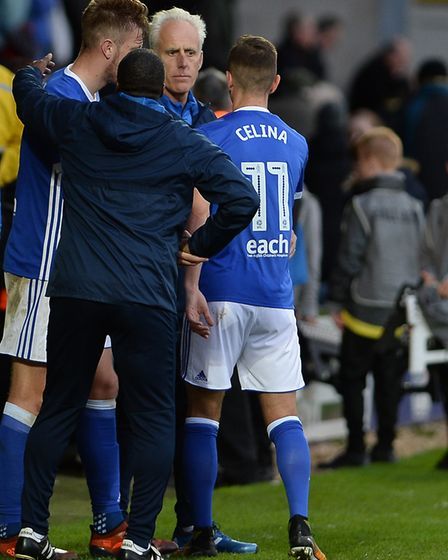 Mick McCarthy greets Bersant Celina after the final whistle at Burton Albion Picture Pagepix