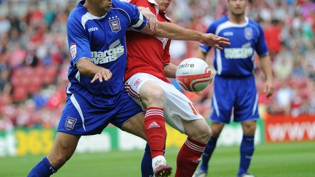 Jon Walters and Nicky Bailey battle for the ball on the Ipswich player's final appearance for the cl