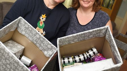 Christmas hampers for the needy. Left to right, Lucy Mortlock and Jayne Green. Picture: GREGG BROWN