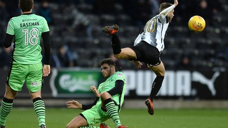 Ryan Inniss, battling with Notts County's Jorge Grant, will miss the trip to Swindon with a shoulder