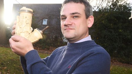 Auctioneer Daniel Wright holding an ornate pipe. Picture: GREGG BROWN
