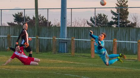Ryan Keeble makes it 2-0 to Woodbridge with a fine curled effort. Picture: PAUL LEECH