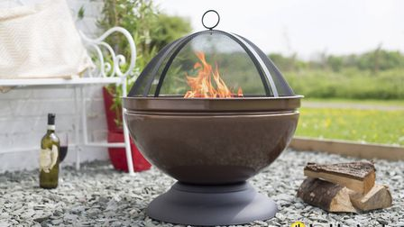 La Hacienda Globe Bronze Effect Firepit with Grill could make someones Christmas. Picture: CONTRIBUT