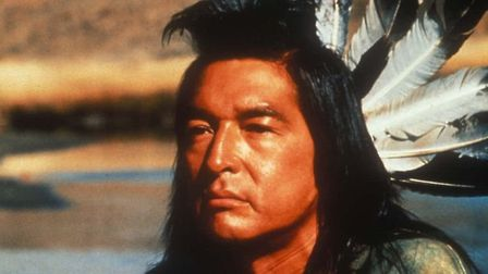 Graham Greene as Kicking Bird in the Oscar-winning film Dances With Wolves - a movie which offered a