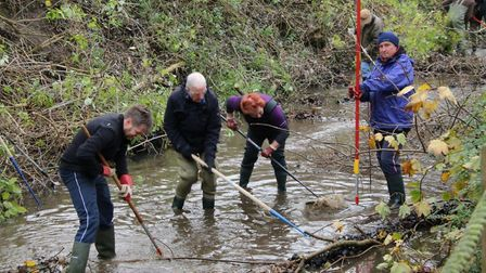 Volunteers from the River Lark Catchment Partnership carrying out a clearing up operation behind Bel