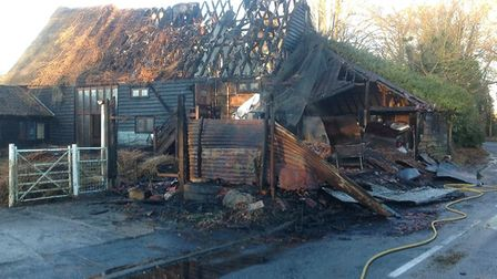 The road was closed by police while firefighters tackled the blaze. Picture: YVONNE WATTS