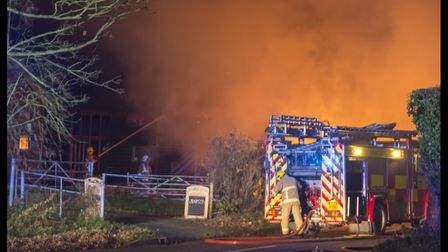 Firefighters worked through the night to put out the thatched blaze. Picture: TERRY TOOZE