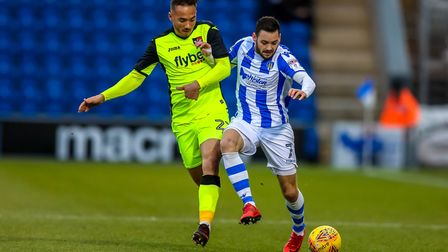 Drey Wright fends off the challenge of Kane Wilson in the first half. Picture: STEVE WALLER WWW.