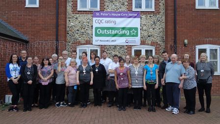 Staff and residents pictured outside St Peter's Court, in Bury St Edmunds, following their 'outstand