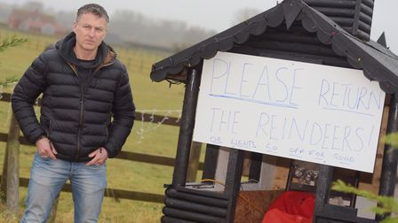 Guy Hayward next to his festive display where the reindeer were stolen from. Picture: SARAH LUCY BR