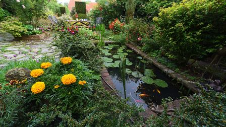 A beautiful garden, considered to be based on a design by Gertrude Jekyll, in Elm Hill, Norwich. DEN