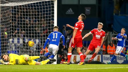 Forest keeper Jordan Smith is beaten by Bersant Celina as he scores Towns 4th. Picture: STEVE WAL