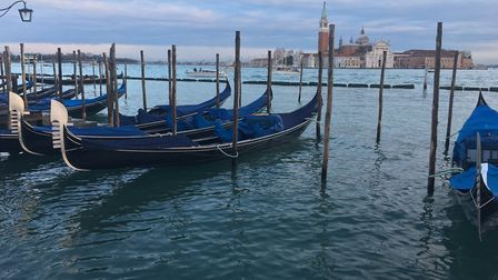 Gondolas moored at sunset in Venice. Picture: LJM