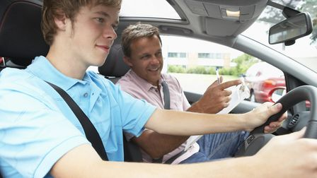 Teenage boy taking a driving lesson with an instructor. Picture: Getty Images/iStockphoto