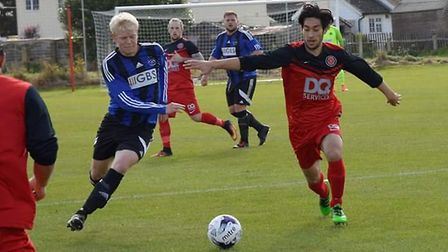 Byron Tejano, right, in action for Henley. Picture: HENLEY ATHLETIC FC
