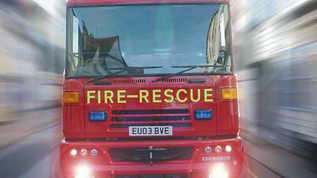 A fire engine on the way to an emergency