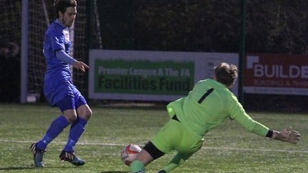 Ryan Weaver rounds the Brantham keeper to set up Charlie Homes' leveller. Picture: GARY BROWN