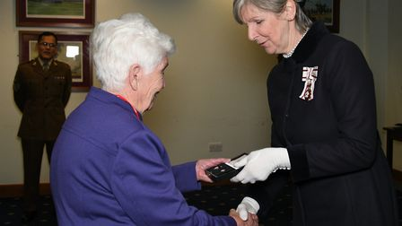Gunner Doe'�s sister Diana Doe was presented with the Elizabeth Cross and memorial scroll by Jennife